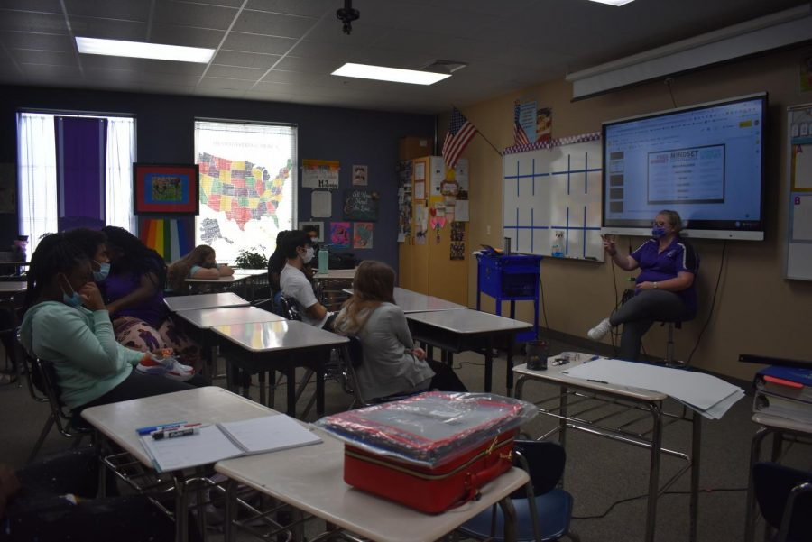 Kimberly Evans discusses with her homeroom class the topic of the day.